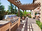Barbecue, plants and lounge chairs on terrace; Indio; California; USA