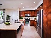 Kitchen with wooden cabinets; San Marcos; California; USA