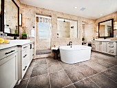 Free-standing bathtub in contemporary bathroom with tiled floor; Brea; California; USA