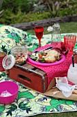 Picnic on picnic blanket in garden