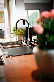 Stainless steel sink with mixer tap fitting