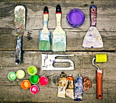 Painter's utensils on wooden table