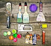 Painter's utensils on wooden table