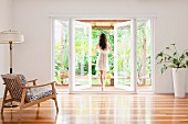 Woman opening French doors to patio