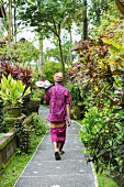 Balinese man walking along path