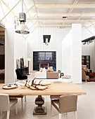 Exhibition room for designer furniture (antlers on dining table, chairs, sofas, cabinet)