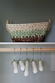 Detail of hangers and basket in cupboard