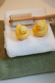 Towel with brush and rubber duckies