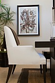Brown cloth on white dining chair