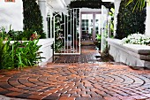 Brick walkway leading to open gate at Laguna Niguel; California; USA