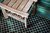 High angle close-up of bench on mosaic floor; Laguna Niguel; California; USA