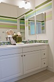 Bathroom with washbasin and large mirror; San Marcos; California; USA