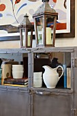 Detail of books, crockery and lanterns in and on cabinet; San Marcos; California; USA