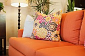 Detail of orange couch with lit standard lamp; Azusa; California; USA