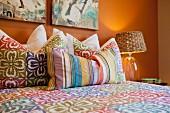Throw pillows arranged on bed; Azusa; California; USA