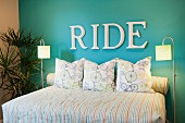 RIDE written on blue accent wall in bedroom; Azusa; California; USA