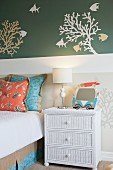Wall decal above bedside table and bed in bedroom
