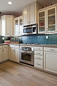 Cabinets and appliances in domestic kitchen