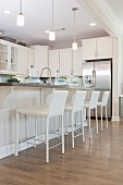 Row of bar stools at kitchen island