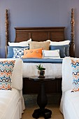 Cushions and pillows arranged on four poster bed; Valencia; California; USA
