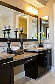 Interior of domestic bathroom with candlestick holders; Valencia; California; USA