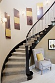Armchair at foot of staircase; Valencia; California; USA