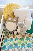 Soft toys in crib in nursery