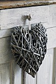 Heart shaped decoration hanging on handle