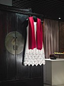 Elegant dress and scarf on coat hanger