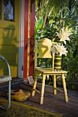 Flower arrangement on chair on porch