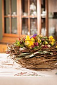 Easter table centre piece with spring flowers & willow twigs