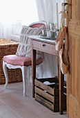 Ballet shoes hanging from handle of interior door and simple washstand next to curved, Rococo-style chair