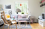 Seating area with corner sofa and Scandinavian wooden furniture in youthful interior