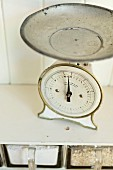 Vintage kitchen scales on white shelf
