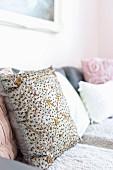 Embroidered cushion on sofa
