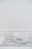 White dog bowl labelled 'Dog'