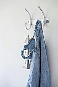 Denim dress with ruffled straps and Oriental lantern hanging from simple, metal coat hooks