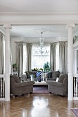 Elegant living room with grey sofa set in villa