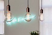 Row of pendant lamps with decorative, vintage-style light bulbs