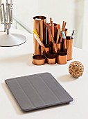 Tablet computer in grey case and copper-coloured pen holder