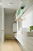 Dressing room with open wardrobe and white drawer module