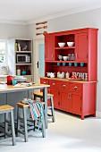 Red dresser in kitchen