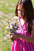 Girl with posy of wild flowers