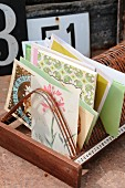 Packets of seeds, gardening reading materials and floral greetings cards in old record rack