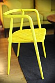 Bright yellow chair with thin seat pad