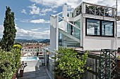 Contemporary penthouse with external staircase leading to raised roof terrace