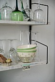 Glasses and bowls on 60s String shelving mounted on wall