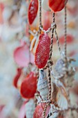 Close up of fishing net decorated with seashells