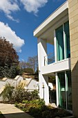 Glass facade of contemporary house in sunshine