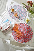Refreshing drinks on crocheted table mats made from the melange yarn on a white table